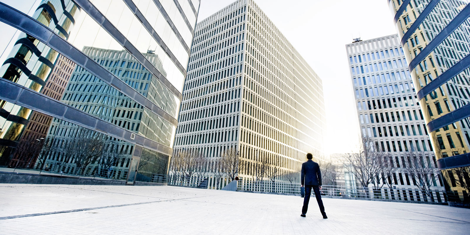 man standing in front of commercial buildings