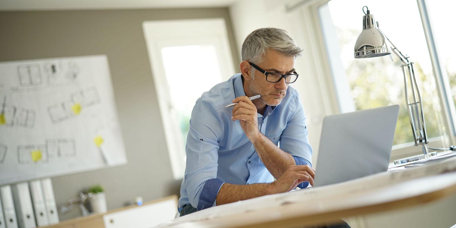 man browsing on his laptop