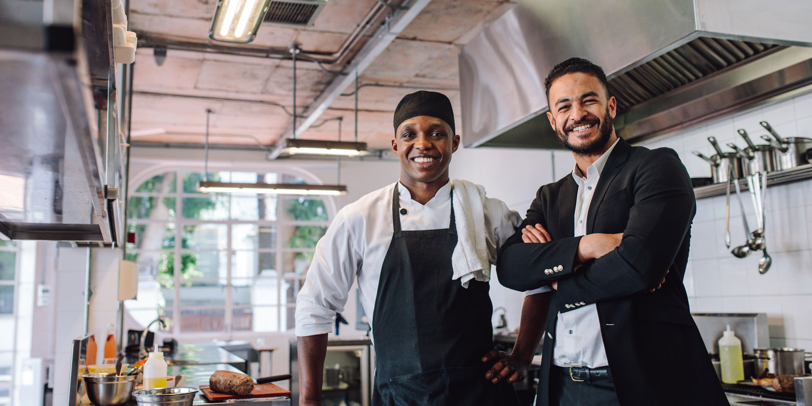 business man taking a photo with a chef